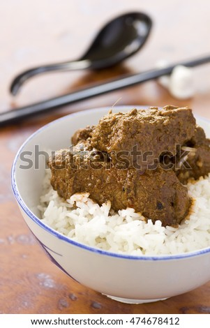 Chinese Styled Pork Rendang on steamed long grain rice. Non sharpened file
