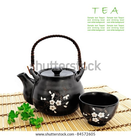 chinese tea ceremony at bamboo mat over white, copyspace for your text - stock photo