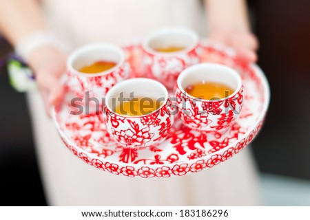 Chinese tea ceremony cups in wedding day - stock photo