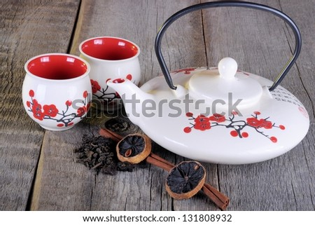 Chinese tea set on a wooden table - stock photo