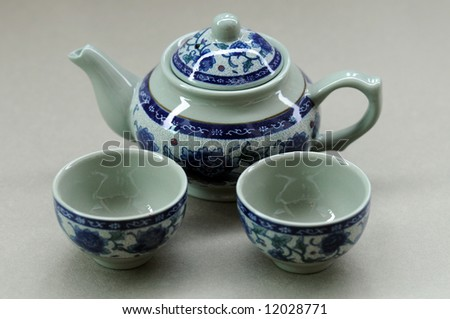 Chinese tea setting with teapot and two cups