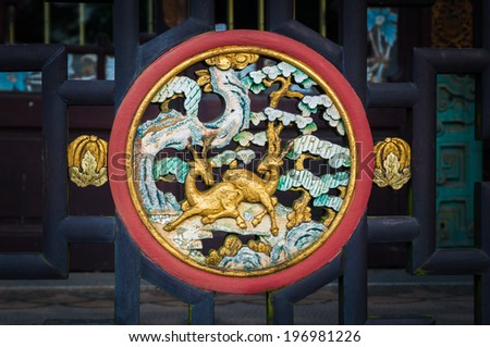 Chinese traditional wood carving on fence - stock photo