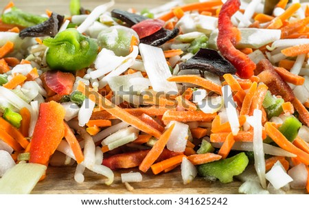 Chinese vegetables sliced in strips on wooden board, selective focus. - stock photo