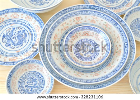 Chinese vintage style blue and white dishes, plate and bowl on the cupboard at home.  - stock photo