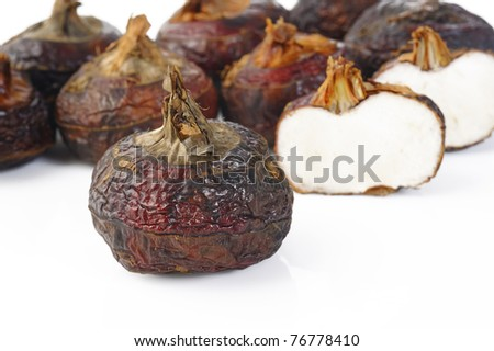 Chinese water chestnut on white - stock photo
