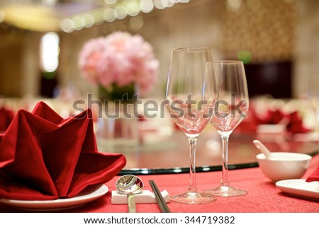 Chinese Wedding table set up with wine glasses  - stock photo