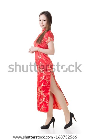 Chinese woman dress traditional cheongsam at New Year, studio shot isolated on white background. - stock photo