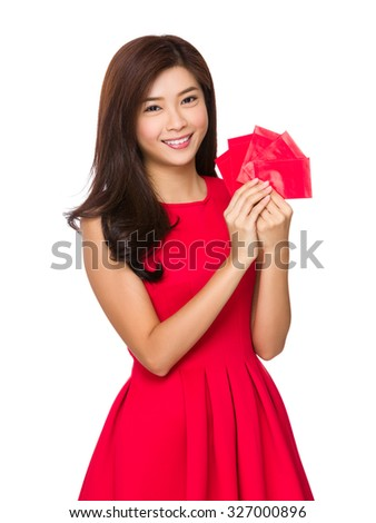 Chinese woman hold with chinese red pocket - stock photo