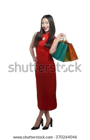 Chinese woman holding shopping bag. Happy chinese new year concept