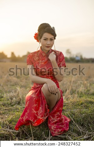Chinese woman red dress traditional cheongsam ,close up portrait - stock photo