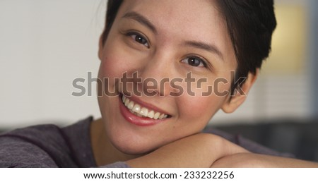 Chinese woman smiling and laughing - stock photo