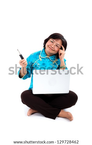 Chinese Woman thinking how to fix laptop, holding screwdriver, on white background - stock photo