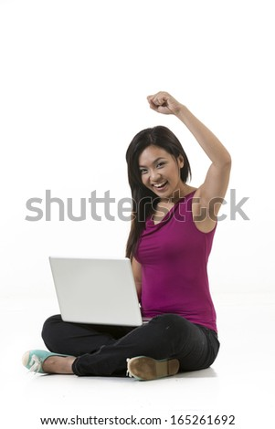 Chinese Woman working on a laptop. Isolated over a white background - stock photo