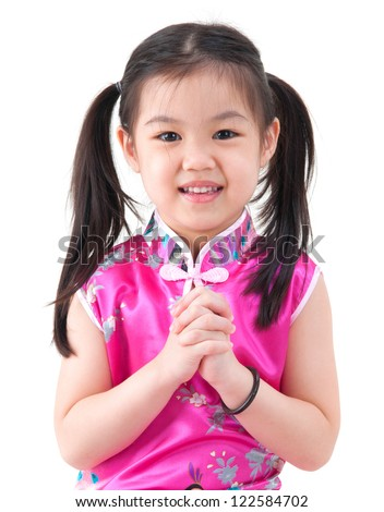 Chinese young girl in traditional Chinese cheongsam blessing, isolated on white background - stock photo