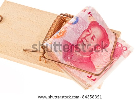 Chinese yuan banknotes in a mousetrap. Debt and budget. - stock photo