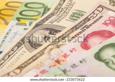 Chinese yuan, European euro notes and American dollars - stock photo