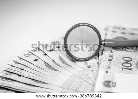 Chinese yuan money with stethoscope costs for the medical insurance with black and white color,Focus on stethoscope - stock photo