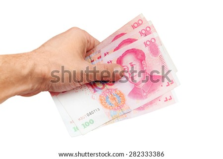 Chinese 100 yuan renminbi banknotes in male hand isolated on white  background
