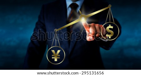 Chinese yuan renminbi outweighing the US dollar on a golden balance. The left hand of a businessman is reaching out to touch this virtual weighing scale and position it in space. Financial metaphor. - stock photo