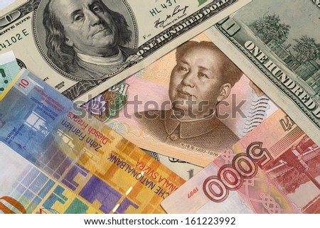 Chinese yuan, us hundred dollar, five thousand russian rubles, ten swiss francs  close up view as a background - stock photo