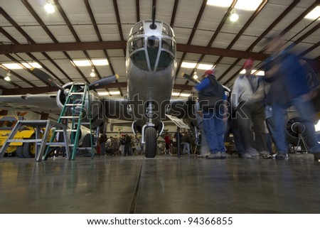CHINO, CA - FEB 4: Planes of Fame museum goers view a B-25 Mitchell on display in Chino, CA on Feb 4, 2012.  The museum prides itself on displaying functional aircraft. - stock photo