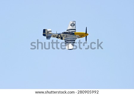 "CHINO/CALIFORNIA - MAY 3, 2015: ""Miss Kandy"" P-51 Mustang vintage military aircraft displaying its flying agility at the Planes of Fame Airshow in Chino, California USA"