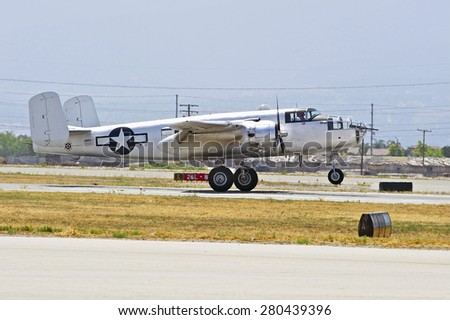 CHINO/CALIFORNIA - MAY 3, 2015: Vintage Military Aircraft on the runway at the Planes of Fame Airshow in Chino, California USA - stock photo