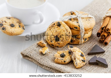Chip cookies with chocolate. Biscuits and coffee for breakfast on a table.
