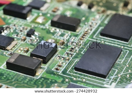 chip on motherboard (mainboard) with controllers, ports and wires - stock photo