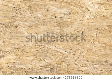 Chipboard wood background and alternative construction material - Texture on wooden panel in construction yard - Retro seamless backdrop pattern - Pressed particleboard for house isolation coating - stock photo