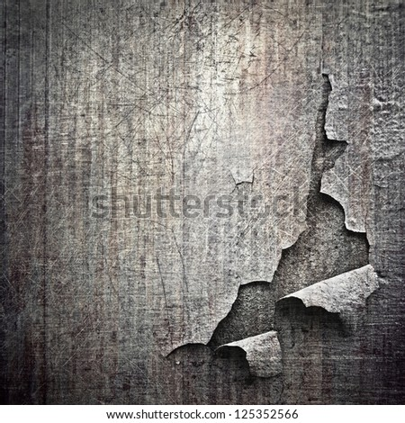 chipped metal plating on scratched  wall , grunge background - stock photo