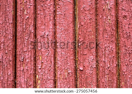 chipped paint on the door of the old boards background - stock photo