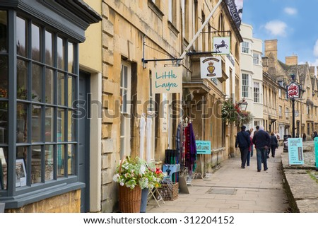 CHIPPING CAMPDEN, UK - OCTOBER 12, 2014:  Quaint stone buildings along the street in Cotswolds in English countryside. - stock photo