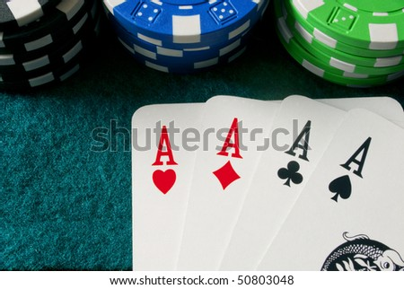 chips and a poker of aces on a gambling table