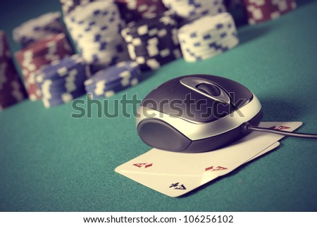 Chips and cards poker in an on line environment. - stock photo