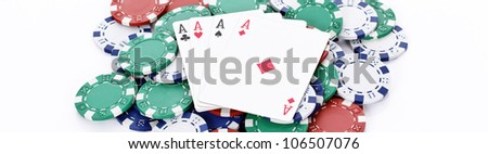 chips and four aces of a kind, panoramic picture - stock photo