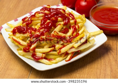 Chips and ketchup - stock photo