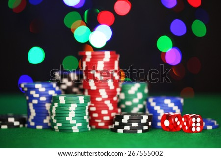 Chips for poker on shiny background - stock photo