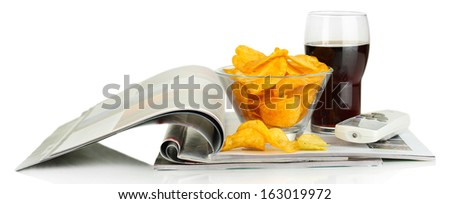Chips in bowl, cola and TV remote isolated on white - stock photo