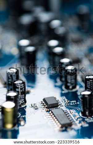 Chips on a blue PCB (detailed close-up shot) - stock photo