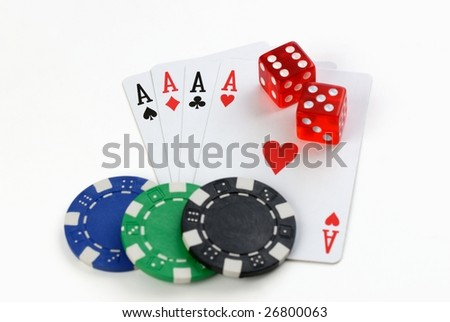 chips, playing cards and dice on the white