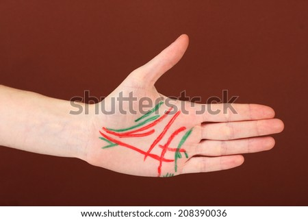 Chiromancy.Color contours on palm, on color background - stock photo
