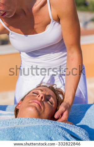 chiropractic massage therapy woman at sea resort