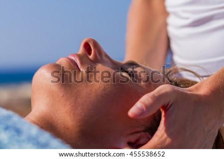 chiropractic massage therapy woman at sea resort - stock photo