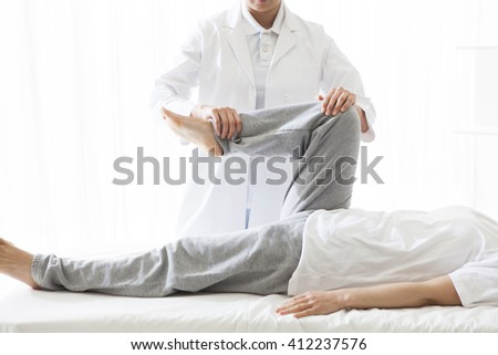chiropractic, mind and body trying to lightly. - stock photo
