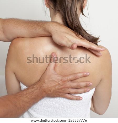 chiropractor applying myofascial therapy    - stock photo