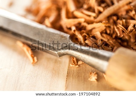 Chisel and wood shavings. Macro image. - stock photo