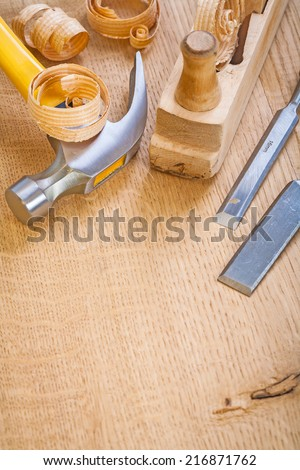 chisel hammer woodworkers plane on wooden board - stock photo