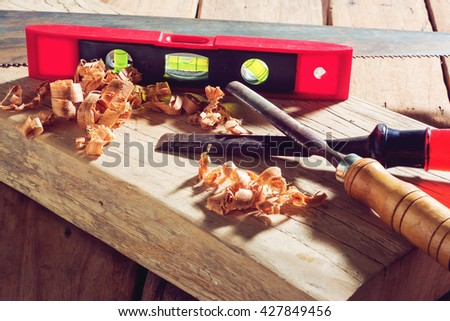 chisel on wood and sawdust. - stock photo