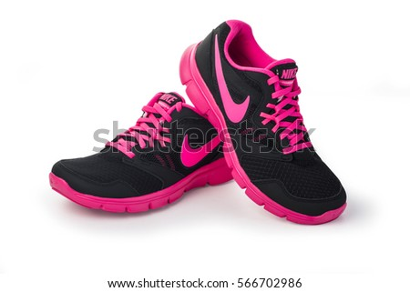 Chisinau, Moldova- May 27, 2015: Nike lady's - women's running shoes - sneakers - trainers, in gray and pink, showing the Nike swoosh logo and sole